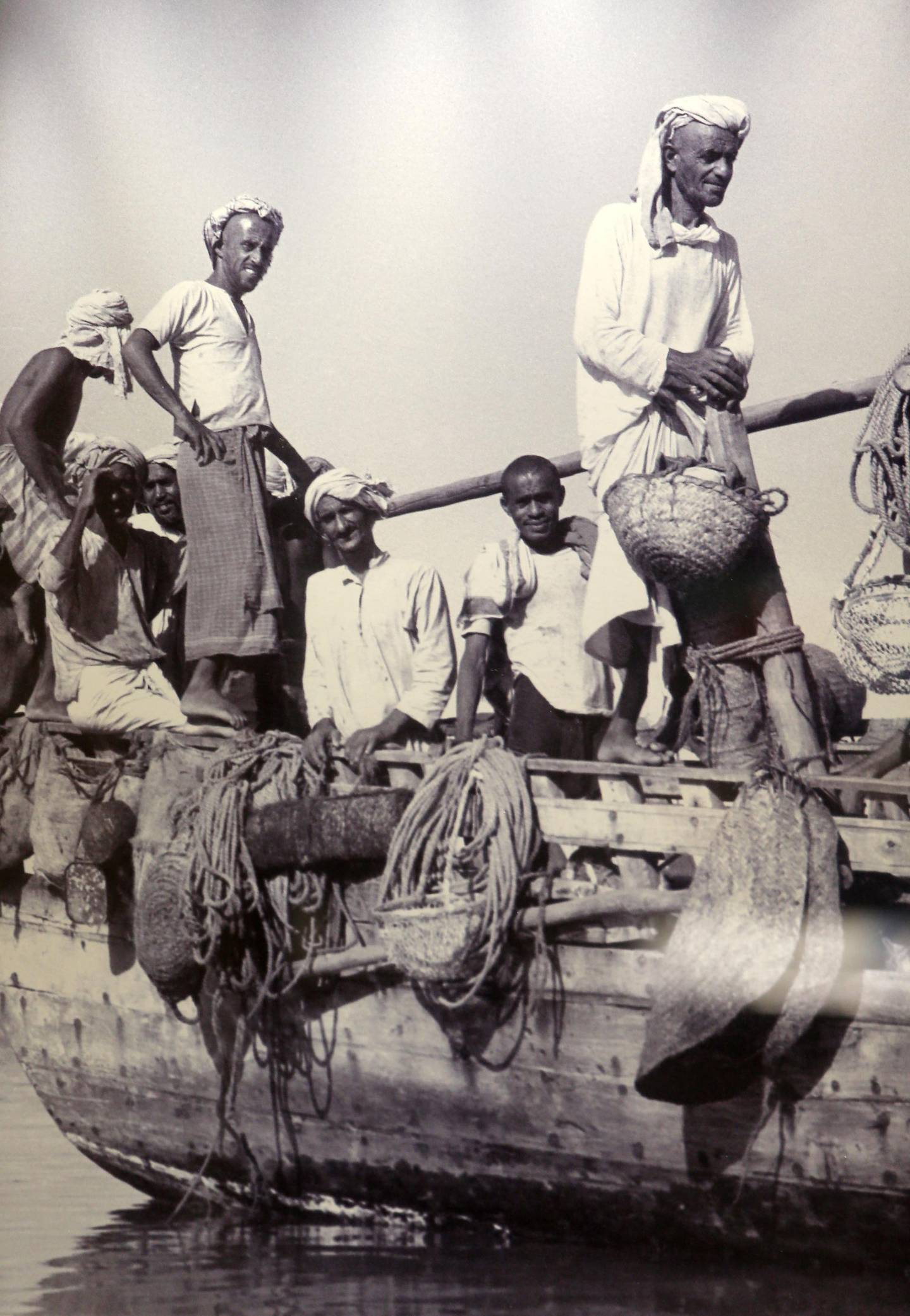 DUBAI , UNITED ARAB EMIRATES – July 16 , 2015 : Old photograph of the pearl divers on display at the Pearl Museum at Emirates NBD head office in Deira Dubai in Dubai. ( Pawan Singh / The National ) For News. Story by Vesela Todorova *** Local Caption ***  PS1607- PEARL MUSEUM25.jpg