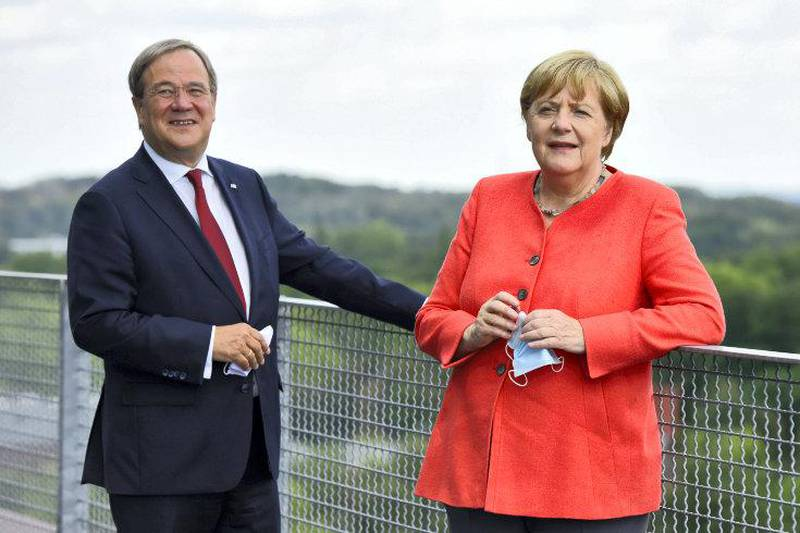 ESSEN, GERMANY - AUGUST 18:  German Chancellor Angela Merkel and North Rhine-Westphalia Governor Armin Laschet visit the Ruhr Conference at the Zeche Zollverein former coal mine and coking plant, today a UNESCO World Heritage site, on August 18, 2020 in Essen, Germany. Merkel attended a North Rhine-Westphalia government cabinet meeting earlier in the day. Laschet is one of three current candidates to succeed Merkel as chancellor candidate for the German Christian Democrats (CDU/CSU).  (Photo by Hauter-Pool/Getty Images)