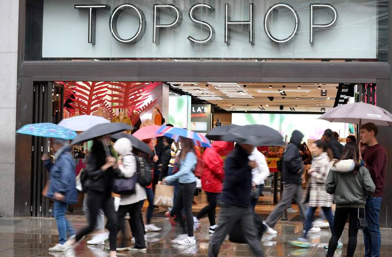 (FILES) In this file photo taken on June 12, 2019 pedestrians and shoppers walk past a Topshop and Topman store, operated by Arcadia, in London. The British ready-to-wear group Arcadia, known for its Topshop brand, filed for bankruptcy on Monday, November 30, swept away by a drop in activity due to the health crisis, announced the firm Deloitte. / AFP / ISABEL INFANTES