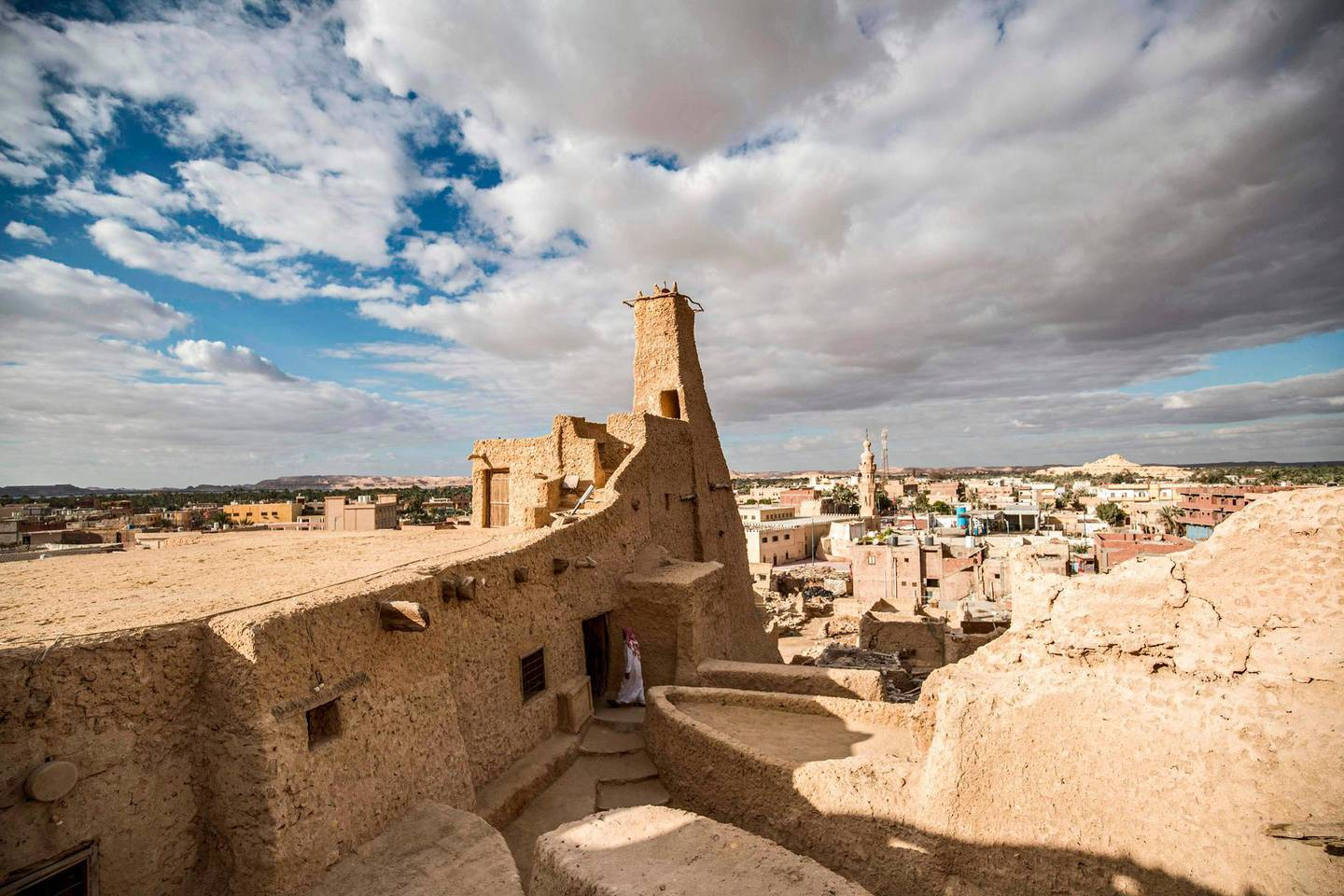 """This picture shows a view of the recently restored fortress of Shali and its surroundings, in the Egyptian desert oasis of Siwa, some 600 kms southwest of the capital Cairo, on November 6, 2020.  The 13th century edifice, called Shali or """"Home"""" in the Siwi language, was built by Berber populations, using kershef, a mixture of clay, salt and rock which acts as a natural insulator in an area where the summer heat can be scorching. After it was worn away by erosion, and then torrential rains in 1926, the European Union and Egyptian company Environmental Quality International (EQI) from 2018 sought to restore the building, at a cost of over $600,000.  / AFP / Khaled DESOUKI"""