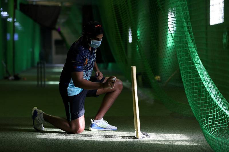 Dubai, United Arab Emirates - Reporter: N/A. News. Coronavirus/Covid-19. Covid safety measures take place as OB of Front foot sports cricket academy disinfects the stumps at United pro sports in Al Quoz. Saturday, October 17th, 2020. Dubai. Chris Whiteoak / The National