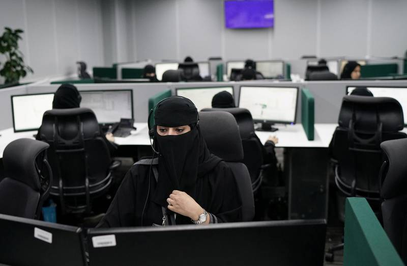 REFILE - CORRECTING DATE Saudi women work at National Center for Security Operations 911 headquarters in the holy city of Mecca, Saudi Arabia August 6, 2019. REUTERS/Umit Bektas