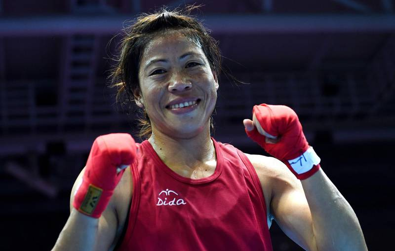 (FILES) This file photo taken on October 01, 2014, shows gold medallist India's Mary Kom reacting after being declared the winner of the women's flyweight (48-51kg) boxing final match against Kazakhstan's Shekerbekova Zhaina during the 2014 Asian Games at the Seonhak Gymnasium in Incheon. She is a five-time world champion, mother of three and member of parliament, but Indian boxer Mary Kom believes that at 35 there is plenty more glory in the ring to come. / AFP PHOTO / INDRANIL MUKHERJEE
