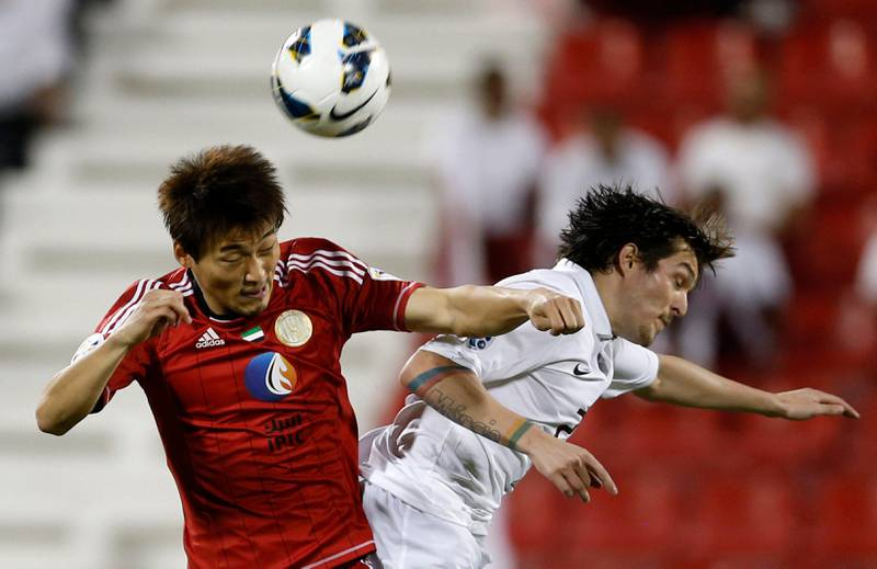 Hyung Min (L) of UAE's Al-Jazira fights for the ball with Qatar's El-Jaish Wagner Renan Ribeiro during their AFC Champions League soccer match at the Al-Rayyan Stadium in Doha April 2, 2013. REUTERS/Fadi Al-Assaad (QATAR - Tags: SPORT SOCCER) *** Local Caption ***  QAT04_SOCCER-ASIAN-_0402_11.JPG
