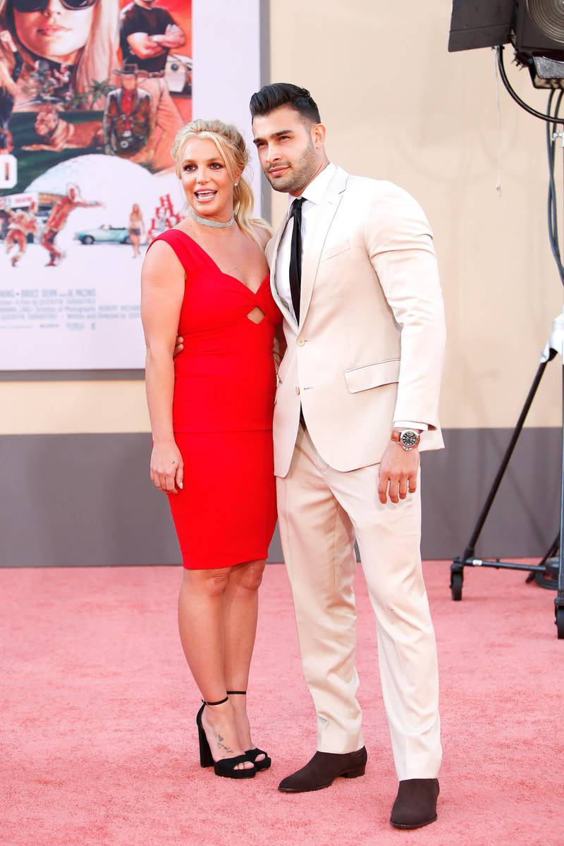 epa07734554 US singer Britney Spears (L) and boyfriend Sam Asghari arrive for the premiere of 'Once Upon a Time in Hollywood' at the TCL Chinese Theatre IMAX in Hollywood, Los Angeles, California, USA, 22 July 2019. The movie opens in the US on 26 July 2019.  EPA-EFE/NINA PROMMER