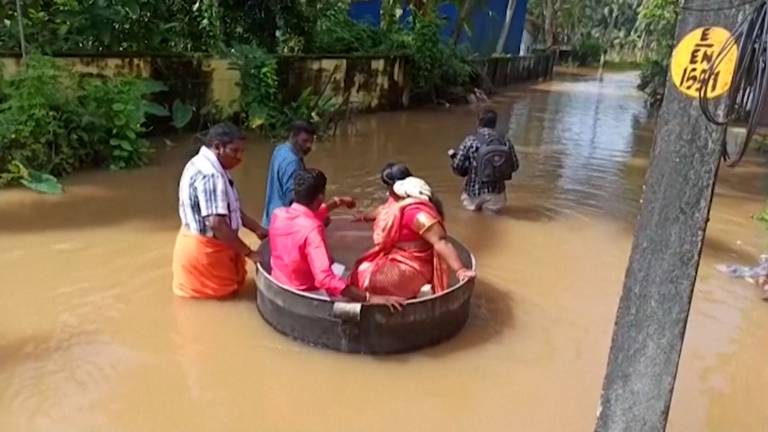 An image that illustrates this article Indian couple use cooking pot to reach wedding venue amid floods