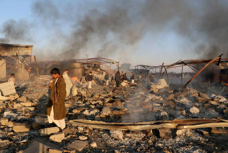 FILE PHOTO: Smoke rises as people inspect damage at the site of air strikes in the city of Saada, Yemen January 6, 2018. REUTERS/Naif Rahma/File Photo