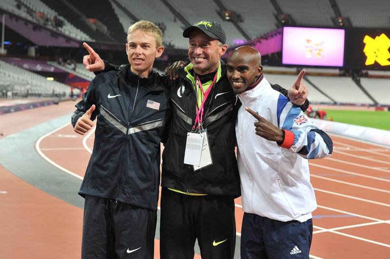 """File photo dated 04-08-2012 of Great Britain's Mo Farah (right) celebrates winning the Men's 10,000m final  with Silver Medalist USA's Galen Rupp (left) and coach Alberto Salazar. PRESS ASSOCIATION Photo. Issue date: Tuesday October 1, 2019. Sir Mo Farah has said in a statement that he has """"no tolerance for anyone who breaks the rules or crosses a line"""" after former coach Alberto Salazar's four-year USADA ban for multiple doping violations. See PA story ATHLETICS Salazar. Photo credit should read Martin Rickett/PA Wire."""