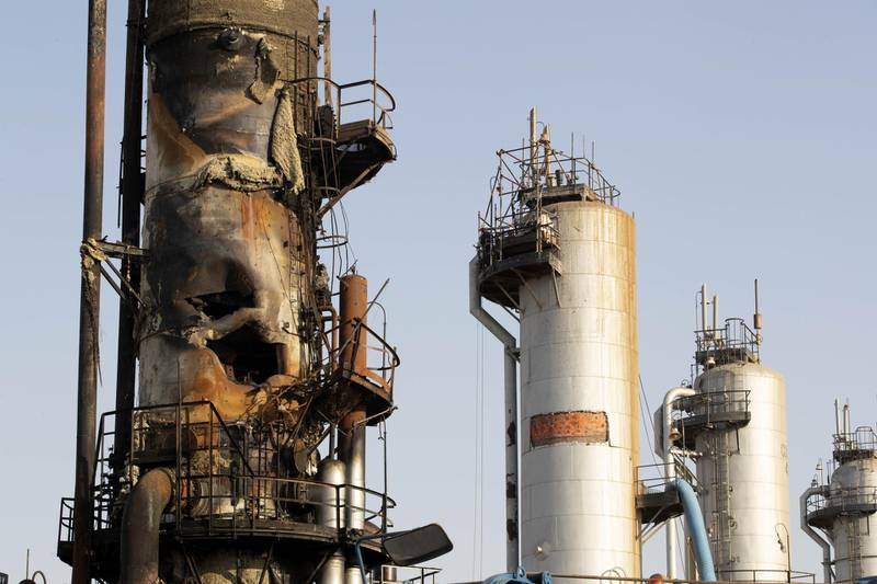 A damaged refining tower stands during repair at Saudi Aramco's Abqaiq crude oil processing plant following a drone attack in Abqaiq, Saudi Arabia, on Friday, Sept. 20, 2019. Saudi Aramcorevealed the significant damage caused by an aerial strike on its Khurais oil field and Abqaiq crude-processing plant last weekend, and insisted that the sites will be back to pre-attack output levels by the end of the month. Photographer: Faisal Al Nasser/Bloomberg