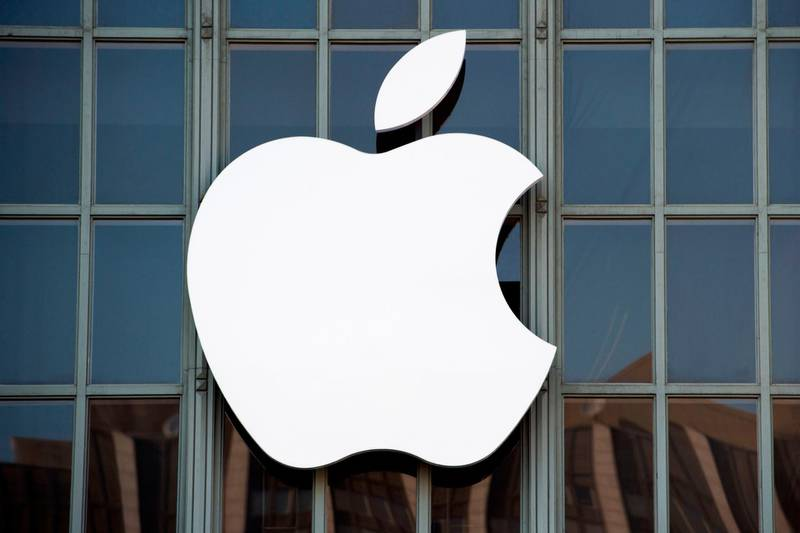"""(FILES) This file photo taken on September 7, 2016 shows the Apple logo on the outside of Bill Graham Civic Auditorium in San Francisco, California. Apple on January 31, 2018 confirmed it is fielding questions from US agencies about its move to slow down older iPhones as batteries weaken.""""We have received questions from some government agencies and we are responding to them,"""" Apple said in an email response to an AFP query.The reply came as comment regarding a Bloomberg report that the US Department of Justice and the Securities and Exchange Commission are investigating whether Apple broke the law by failing to disclose a software update that made older iPhone models function slower.  / AFP PHOTO / Josh Edelson"""