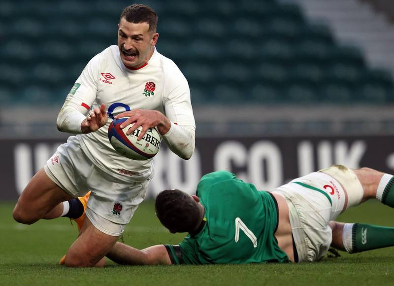 England's wing Jonny May (L) scores their second try during the Autumn Nations Cup international rugby union match between England and Ireland at Twickenham in London, on November 21, 2020. / AFP / Adrian DENNIS