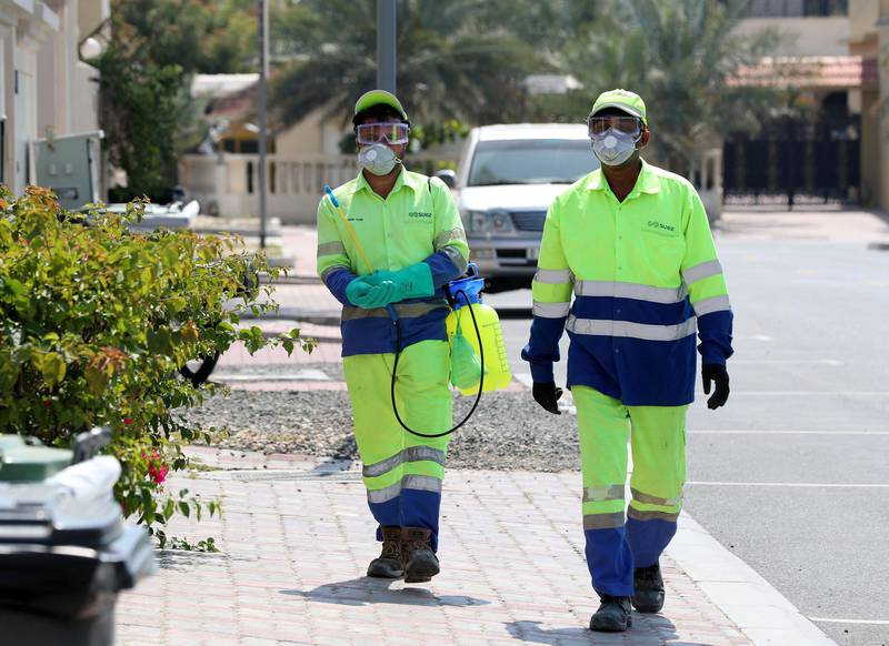 Dubai, United Arab Emirates - Reporter: N/A: People disinfect bins in Jumeirah in response to the corona virus. Wednesday, March 25th, 2020. Dubai. Chris Whiteoak / The National