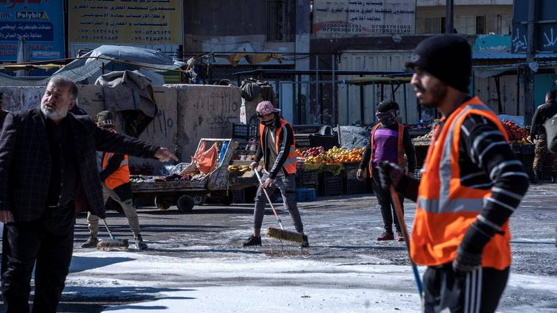 Clean up operations begin at the site of a suicide attack in a central market in Baghdad. Haider Husseini/ The National