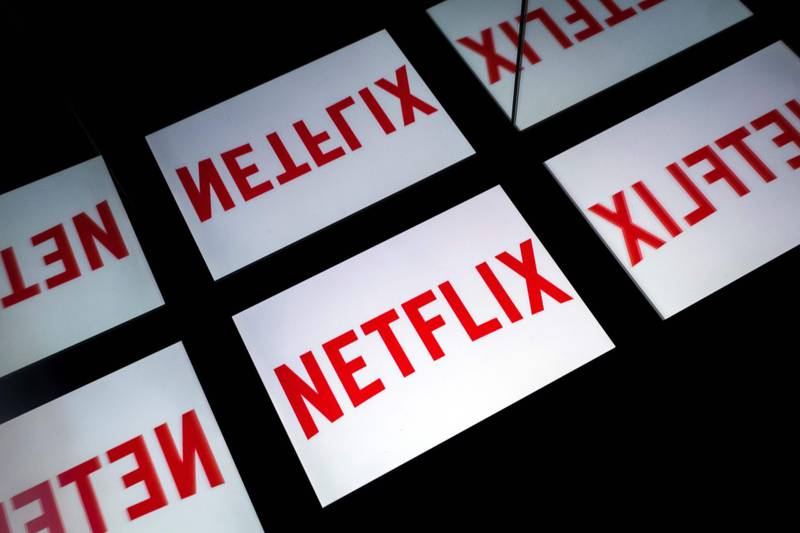 (FILES) In this file photo taken on February 18, 2019 This illustration picture shows the US Online Streaming giant Netflix logo displayed on a tablet in Paris. It may already have Oscars under its belt, but Netflix's acceptance by the Academy of Motion Picture Arts and Sciences hangs in the balance. The prestigious body is set to reexamine whether the streaming giant will remain eligible for such awards, despite a warning from the US Justice Department that could violate antitrust laws.  / AFP / Lionel BONAVENTURE