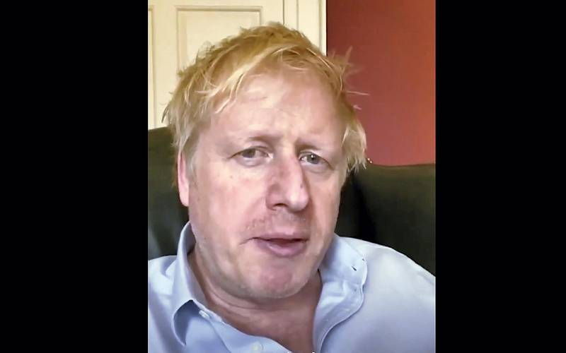"""A still image from footage released by 10 Downing Street, the office of the British prime minister, on April 3, 2020 shows Britain's Prime Minister Boris Johnson in 10 Downing Street central London giving an update on his condition after he announced that he had tested positive for the new coronavirus on March 27, 2020. - British Prime Minister Boris Johnson was in """"good spirits"""" on April 6 and remained in charge of the government despite his admission to hospital for tests after suffering """"persistent symptoms"""" of coronavirus 10 days after being diagnosed, officials said. (Photo by - / 10 Downing Street / AFP) / RESTRICTED TO EDITORIAL USE - MANDATORY CREDIT """"AFP PHOTO / 10 DOWNING STREET """" - NO MARKETING - NO ADVERTISING CAMPAIGNS - DISTRIBUTED AS A SERVICE TO CLIENTS"""