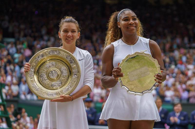 FILE PHOTO: Jul 13, 2019; London, United Kingdom; Serena Williams (USA) and Simona Halep (ROU) pose with their trophies after the women's final on day 12 at the All England Lawn and Croquet Club. Mandatory Credit: Susan Mullane-USA TODAY Sports/File Photo