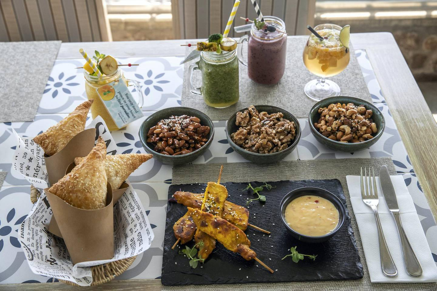 DUBAI, UNITED ARAB EMIRATES. 06 OCTOBER 2020. JA Hatta Fort Hotel has launched a collaboration with the Hatta Honey Bee Discovery Centre to use theyr products in the Food and Beverage menu of the hotel. Menu items at the Hotel. Feta and Honey puff pastry, glazed nuts, honey glazed chicken Satay with Japanese Mayo and lemon grass along with the juices, Non Alcoholic Sangria, Rassberry Love, Green Machine and Mango Paradise. (Photo: Antonie Robertson/The National) Journalist: janice Rodriguez. Section: Arts & Life.