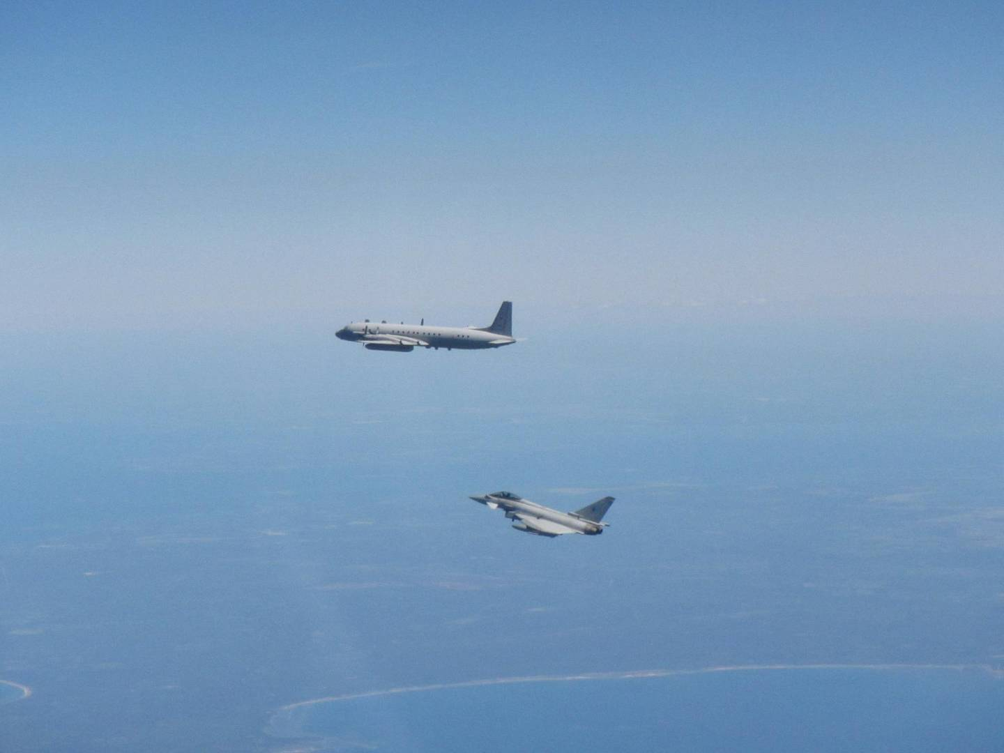 epa08461212 A handout picture provided by the British Royal Air Force shows a Russian Coot A aircraft (top) being intercepted by RAF Typhoons from Siauliai Air Base, over Lithuania, 02 June 2020. According to the RAF, jets of the NATO Baltic Air Policing mission intercepted a Russian aircraft.  EPA/Iain Curlett / BRITISH MINISTRY OF DEFENCE HANDOUT MANDATORY CREDIT: MOD/CROWN COPYRIGHT HANDOUT EDITORIAL USE ONLY/NO SALES