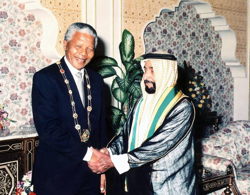 Sheikh Zayed Bin Sultan Al Nahyan awarding the 'Zayed Medal of Honor' to Nelson Mandela during his first visit to the UAE in 1998, and Nelson Mandela awarding Sheikh Zayed the highest honour of South Africa at Al Mushrif Palace, 11th April  1995 Source: WAM  National Archives images supplied by the Ministry of Presidential Affairs to mark the 50th anniverary of Sheikh Zayed Bin Sultan Al Nahyan becaming the Ruler of Abu Dhabi. *** Local Caption ***  86 a.jpg