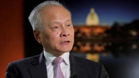 China's man in America breaks with ministry officials on virus claims