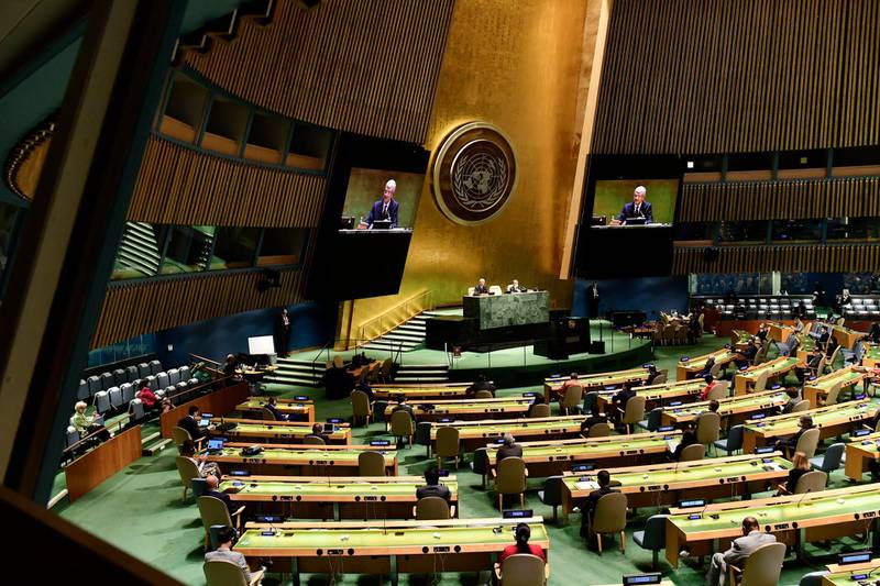 Opening of 75th session of General AssemblyA wide view of the General Assembly Hall as Volkan Bozkir (left at dais and on screens), President of the seventy-fifth session of the United Nations General Assembly, chairs the 1st plenary meeting of the seventy-fifth session of the General Assembly. At right at dais is Secretary-General António Guterres.15 September 2020. UN Photo/Evan Schneider
