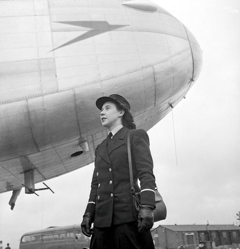 April 1946:  Miss B Midgley of Northolt aerodrome stands under the nose of a BOAC (British Overseas Airways Corporation) aircraft. She is one of ten 'air traffic girls' currently taking part in a course at Hurn airport, to learn how to deal professionally with passengers.  (Photo by George Konig/Keystone Features/Getty Images)