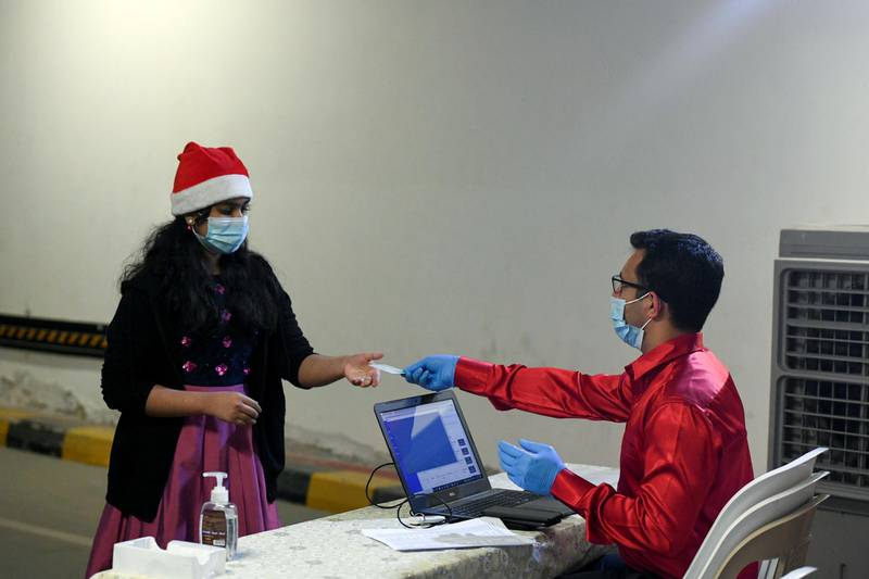 Abu Dhabi, United Arab Emirates - Counters have been set up so worshippers can validate online registrations by swiping their Emirates identity cards for midnight mass at St. PaulÕs Catholic Church, Mussafah. Khushnum Bhandari for The National