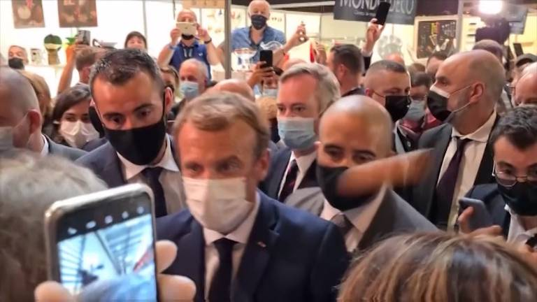 An image that illustrates this article Emmanuel Macron gets hit with an egg