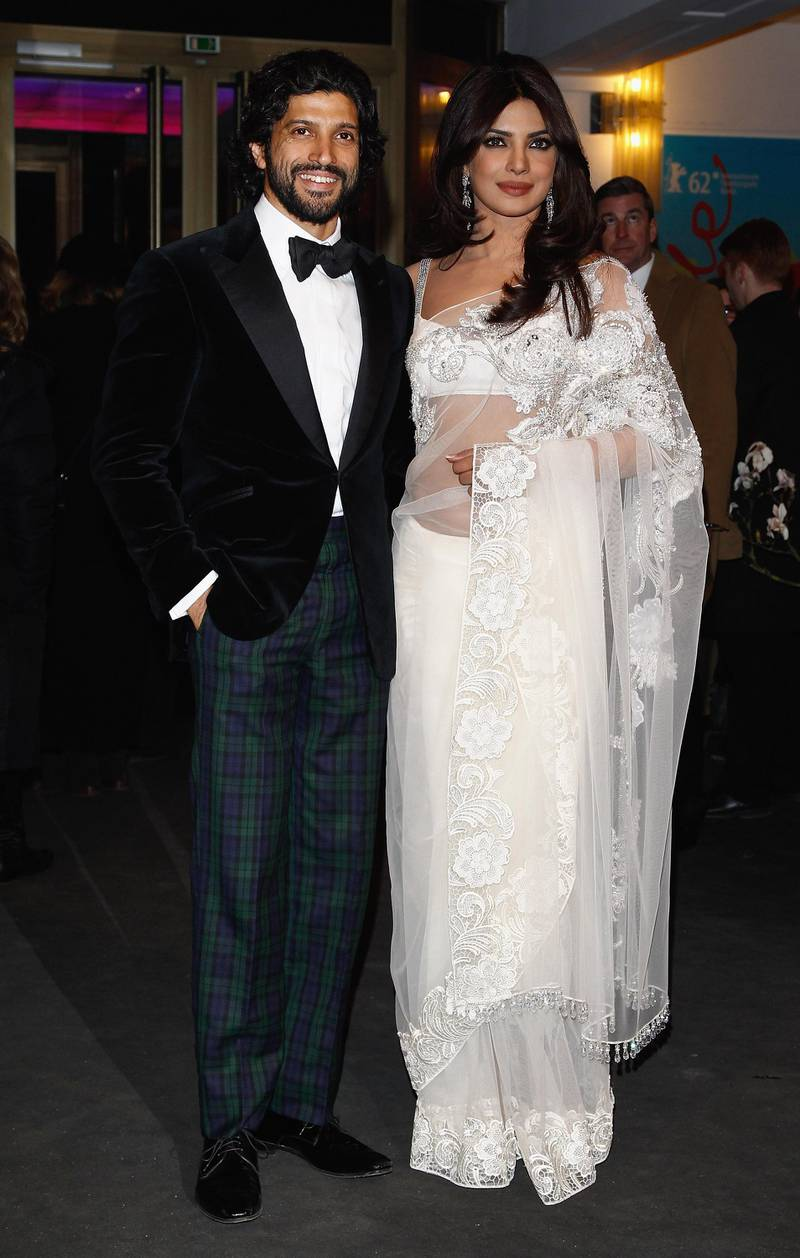 """BERLIN, GERMANY - FEBRUARY 11:  Director Farhan Akhtar and actress Priyanka Chopra attend the """"Don - The King Is Back"""" Premiere during day three of the 62nd Berlin International Film Festival at the Friedrichstadtpalast on February 11, 2012 in Berlin, Germany.  (Photo by Andreas Rentz/Getty Images)"""
