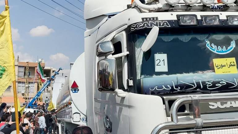 An image that illustrates this article Residents cheer as lorries carrying Iranian fuel arrive in Lebanon