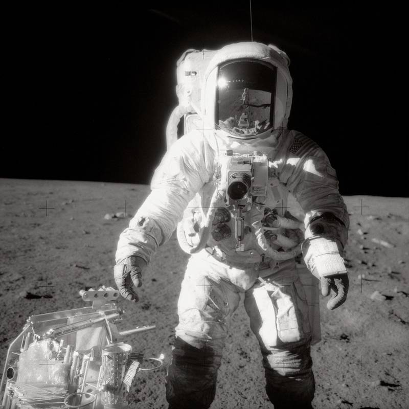 epa06766296 An undated handout file photo made available by NASA on 27 May 2018 shows astronaut Alan Bean, Lunar Module pilot, pausing near a tool carrier during the Apollo 12 spacewalk on the moon's surface. Commander Charles Conrad, Jr., who took the black-and-white photo, is reflected in Bean's helmet visor. Bean, who was the fourth person to walk on the moon, passed away on 26 May 2018 in Houston, Texas at the age of 86.  EPA/NASA HANDOUT -- BLACK AND WHITE -- HANDOUT EDITORIAL USE ONLY/NO SALES