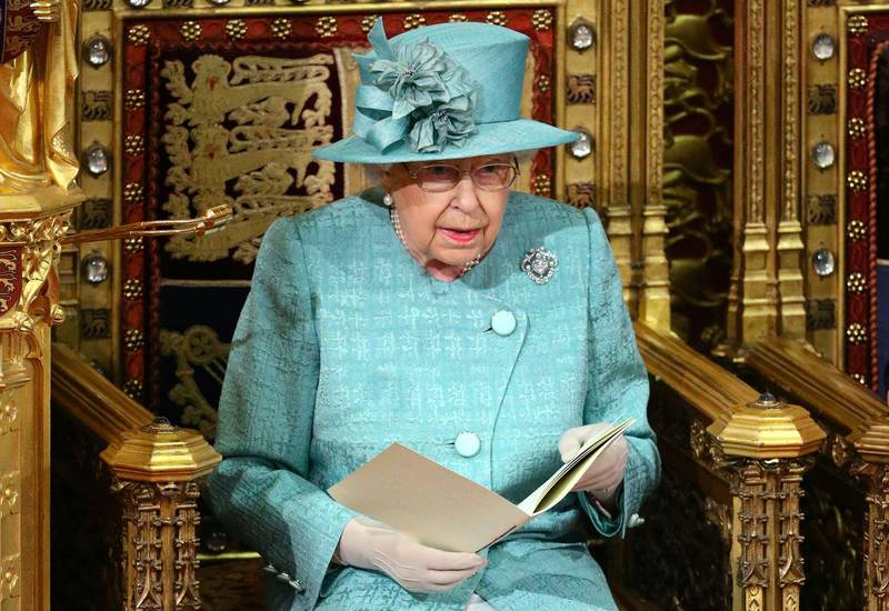 Britain's Queen Elizabeth II reads the Queen's Speech on the The Sovereign's Throne in the House of Lords chamber, during the State Opening of Parliament in the Houses of Parliament in London on December 19, 2019. The State Opening of Parliament is where Queen Elizabeth II performs her ceremonial duty of informing parliament about the government's agenda for the coming year in a Queen's Speech. / AFP / POOL / Aaron Chown