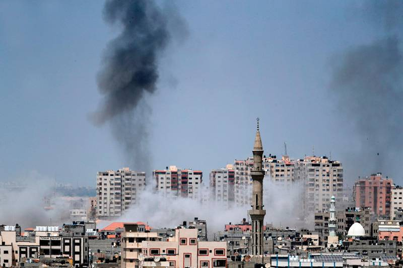 A picture taken from Gaza City on May 29, 2018, shows a smoke billowing in the background following an Israeli air strike on the Palestinian enclave. Israel struck bases of militant groups in the Gaza Strip, the enclave's Islamist rulers Hamas said, hours after nearly 30 mortar shells were fired at the Jewish state. / AFP / THOMAS COEX