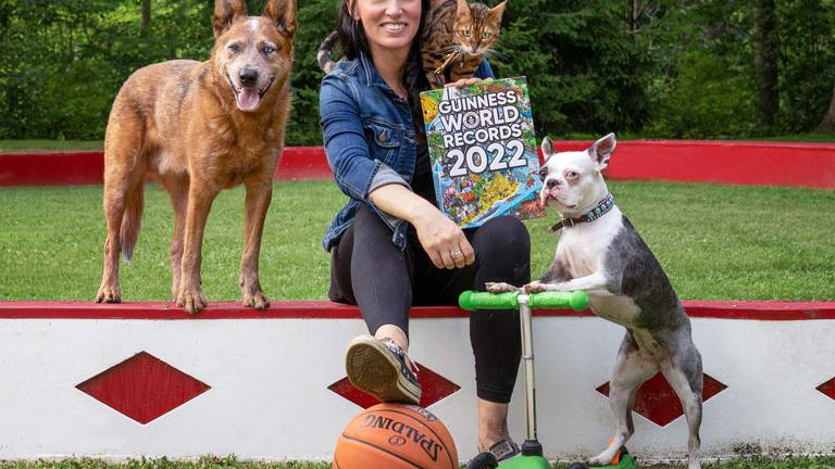 An image that illustrates this article Guinness World Records 2022 includes fastest pets on a scooter