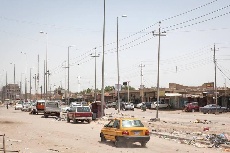 A car drives along a street of Basra, a major city in south Iraq. Photo by Sebastian Castelier