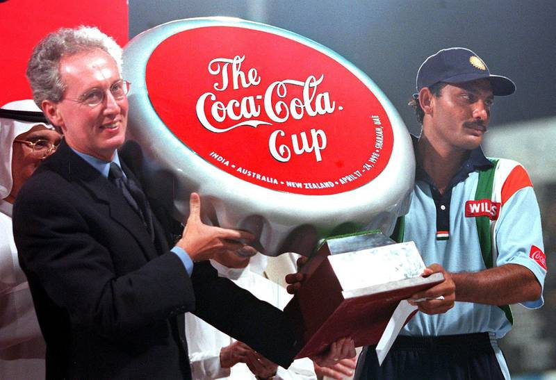 Indian captain Mohamed Azharuddine (R) receives the Coca Cola trophy after winning the Sharjah cricket final against Australia 25 April. (Photo by RABIH MOGHRABI / AFP)
