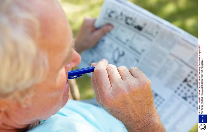 Mandatory Credit: Photo by Monkey Business Images/REX (1492994a) MODEL RELEASED Senior man with newspaper VARIOUS   *** Local Caption ***  hl26mr-sudoku.jpg