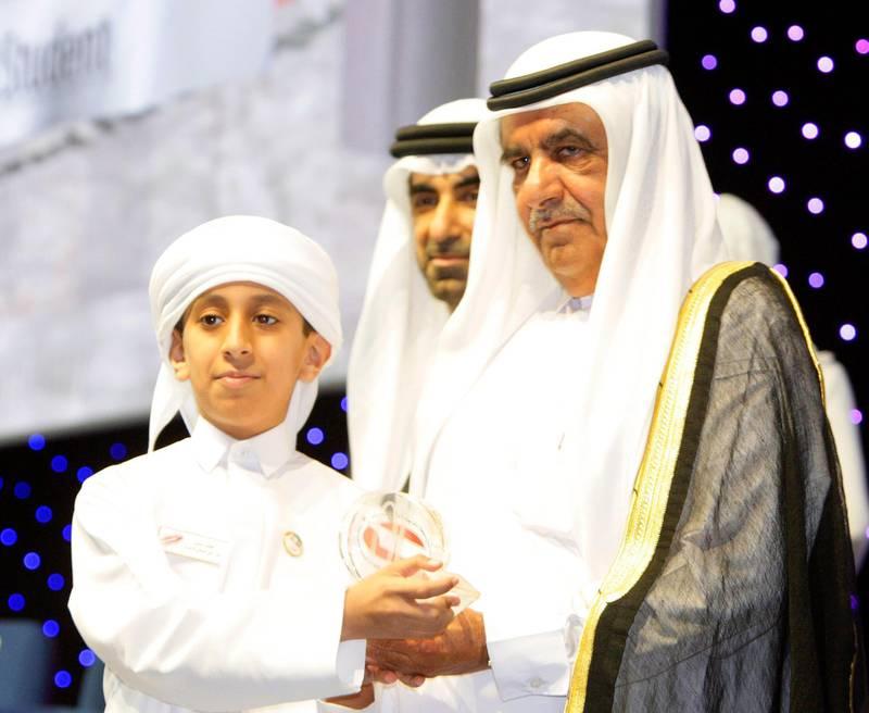 Dubai-UAE, 8 April 2008.  Sheikh Hamdan Bin Rashid Al Maktoum (Deputy Ruler of Dubai) distributed the awards, with him is Omar Aly Saeef Al Shkay Al Zyody (Abu Dhabi Education Zone) one of the recepient of the Distinguished Student Award.  Also seen was Dr. Hanif Hassan Ali (Minister of Education).  Held at the Dubai International Convention Center. ( Jeffrey E. Biteng / The National ) *** Local Caption *** JB0452-HamdanAwards.jpg