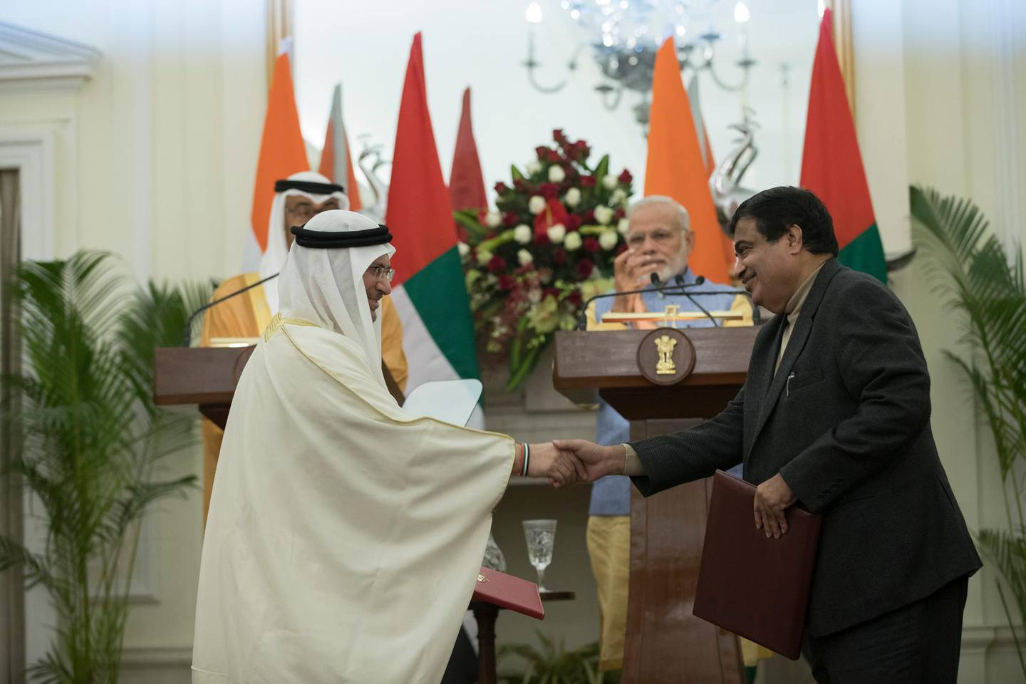 NEW DELHI, INDIA - January 25, 2017: HE Dr Anwar bin Mohamed Gargash, UAE Minister of State for Foreign Affairs (L) and Shri Nitin Gadkari, Minister for Road Transport and Highways and Shipping (R) stand for a photograph after the signing of an MOU between the Government of the Republic of India and the Government of the UAE on 'Institutional Cooperation on Maritime Transport', at Hyderabad House. ( Mohamed Al Hammadi / Crown Prince Court - Abu Dhabi ) --- *** Local Caption ***  20170125MH_C189464.jpg