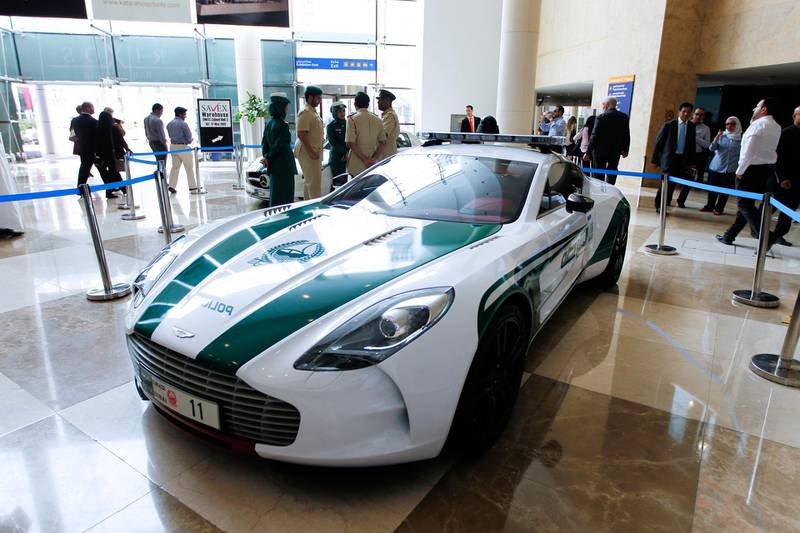 Dubai, May 6, 2013 - Dubai Police showed off their new fleet of luxury patrol cars including an Aston Martin ONE77 at the Arabian Travel Market at Dubai International Convention and Exhibition Centre, May 6, 2013.(Photo by: Sarah Dea/The National)