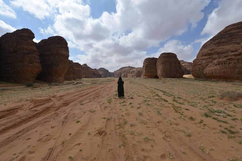 A Saudi woman walks in the Sharaan Nature Reserve near the town of al-Ula in northwestern Saudi Arabia on February 11. 2019.  / AFP / FAYEZ NURELDINE
