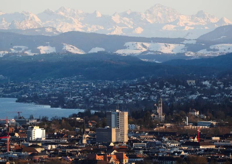 FILE PHOTO: The Verwaltungszentrum Werd administration center is seen in front of the eastern Swiss Alps and Lake Zurich in Zurich, Switzerland, April 8, 2021.  REUTERS/Arnd Wiegmann/File Photo