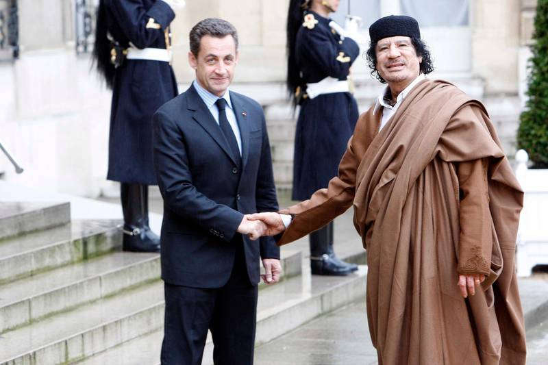 PARIS, FRANCE- DECEMBER 10: French President Nicolas Sarkozy welcomes Colonel Gaddafi at Le palais de l'Elysee on December 10, 2007 in Paris, France. The Libyan leader Muammar Gaddafi will spend five days in France, his first visit in over 30 years, to discuss trade and military deals. (Photo by Michel Dufour/WireImage)