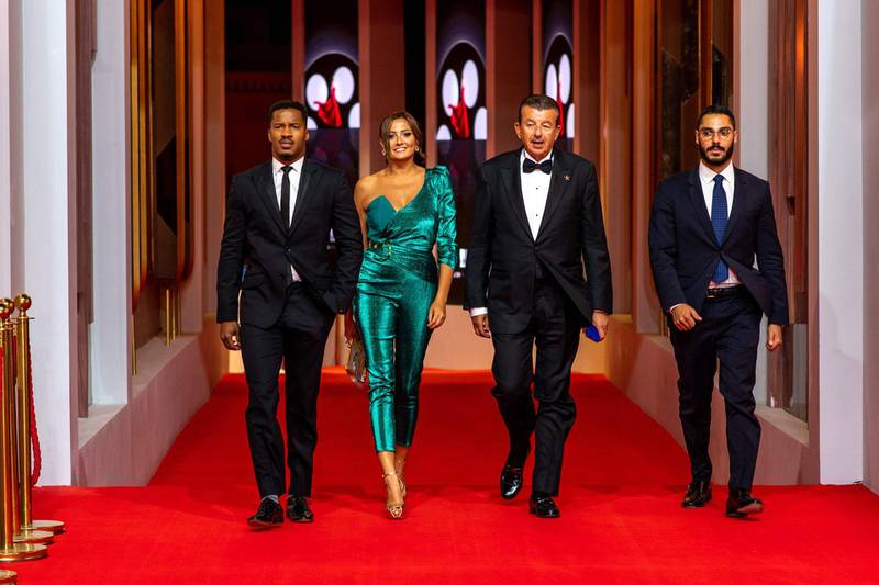 """(L to R) Nate Parker, Bushra Roza, Tarak Ben Ammar and Jad Ben Ammar arrive for the screening of """"Sisters in Arms"""" during the third edition of the Gouna Film Festival (GFF), in the Egyptian Red Sea resort of el-Gouna on September 21, 2019.  / AFP / El Gouna Film Festival / Ammar Abd Rabbo"""