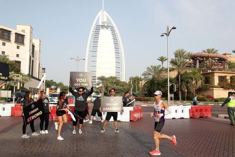 Dubai, United Arab Emirates - January 25, 2019: People run in the Standard Chartered Dubai Marathon 2019. Friday, January 25th, 2019 at Jumeirah, Dubai. Chris Whiteoak/The National