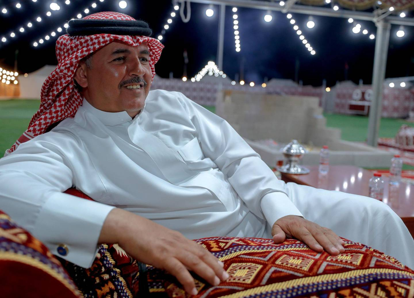 Abu Dhabi, United Arab Emirates, December 10, 2019.    ---Mohammed Fahd Al Ulayan, 48, from Saudi Arabia relaxes at his tent at the Al Dhafra Festival in Abu Dhabi.Victor Besa/The NationalSection:  NAReporter:  Anna Zacharias