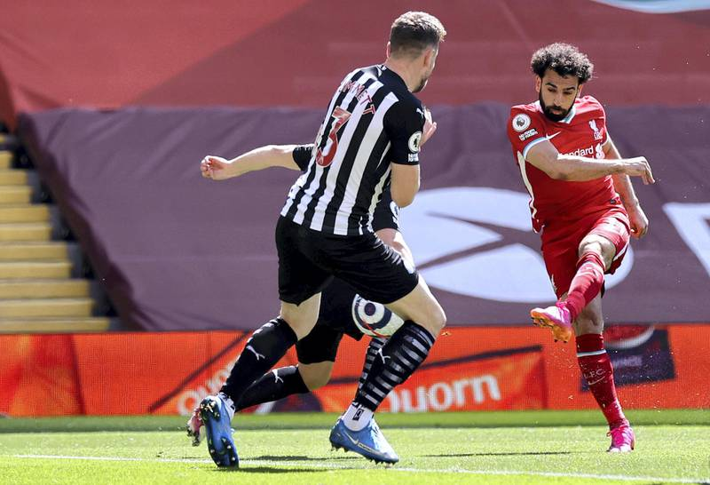 LIVERPOOL, ENGLAND - APRIL 24: Mohamed Salah of Liverpool scores their side's first goal during the Premier League match between Liverpool and Newcastle United at Anfield on April 24, 2021 in Liverpool, England. Sporting stadiums around the UK remain under strict restrictions due to the Coronavirus Pandemic as Government social distancing laws prohibit fans inside venues resulting in games being played behind closed doors.  (Photo by David Klein - Pool/Getty Images)