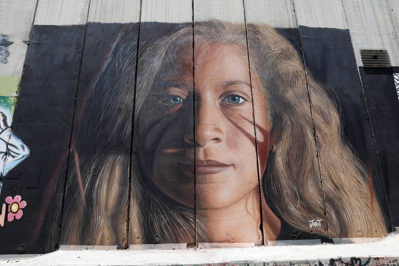 epa06917211 A view of a mural depicting Ahed Tamimi, a 17-year-old Palestinian campaigner against Israel's occupation, on the Israeli separation wall in the West Bank city of Bethlehem, 29 July 2018. Ahed Tamimi, who was arrested last December after she was filmed slapping an Israeli soldier near Ramallah, in the occupied West Bank, was released from prison on 29 July 2018 after serving nearly eight-month in detention.  EPA/ABIR SULTAN
