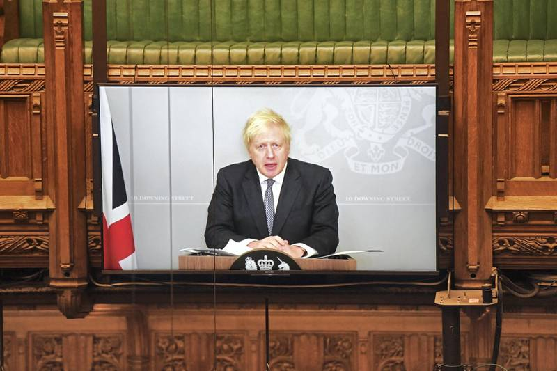 """A handout photograph released by the UK Parliament shows Britain's Prime Minister Boris Johnson attending the House of Commons remotely by video-link to update MPs on the COVID-19 pandemic, in a hybrid, socially distanced session at the House of Commons in London on November 23, 2020. - Britain's Prime Minister Boris Johnson on Monday expressed optimism for an end to coronavirus restrictions as he announced the lifting of measures in England from early next month. Johnson was forced into self-isolation after meeting with one of his MPs who consequently tested positive for coronavirus. (Photo by JESSICA TAYLOR / UK PARLIAMENT / AFP) / RESTRICTED TO EDITORIAL USE - NO USE FOR ENTERTAINMENT, SATIRICAL, ADVERTISING PURPOSES - MANDATORY CREDIT """" AFP PHOTO / Jessica Taylor /UK Parliament"""""""