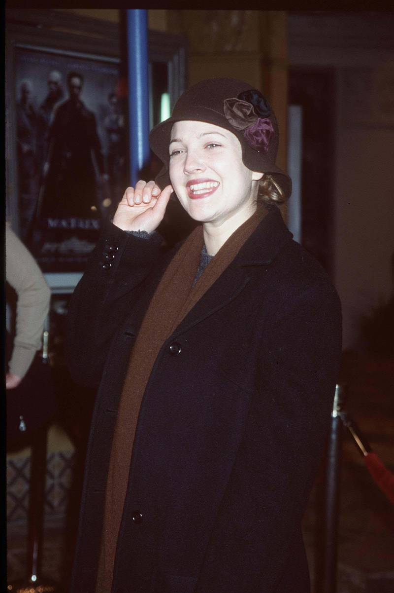 """03/24/99. Westwood, CA. Drew Barrymore arrives at the world premiere showing of the new film """"The Matrix"""" at the Mann's Village Theatre. Photo Brenda Chase/Online USA, Inc./Getty Images"""